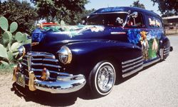 """George Luna's 1947 Chevrolet Sedan Delivery, christened """"Midnight Illusions,"""" took three years to customize for the lowrider show circuit."""
