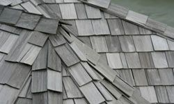 Treating a shingled roof with reflective pigment can help make it a greener option.