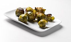 No one will turn up a nose at grilled brussels sprouts flavored with butter and bacon bits.