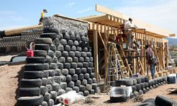 You can see both tires and bottles in the construction of this Earthship at the Greater World Earthship Community in Taos, New Mexico.