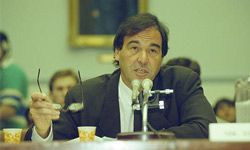 """""""JFK"""" director Oliver Stone testifies before a House subcommittee to seek the release of documents concerning President Kennedy's assassination."""