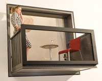The window tranforms into a lovely balcony for street watching and sipping drinks.