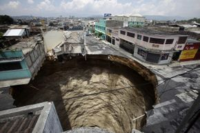 A giant sinkhole swallowed homes, streets and businesses following flooding resulting from tropical storm Agatha in 2010.