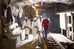Miners walk through the Savuka gold mine in South Africa.