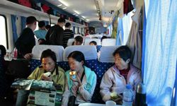 Three Chinese women review a map aboard the Qinghai-Tibet Railway on the way to Xinning. Although it's the highest-altitude train in the world, the Qinghai-Tibet Railway has critics who worry about the effect the train will have on the cultures touched along the route.