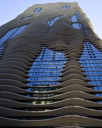 Inspired by the waters of Lake Michigan, the rippling Aqua Tower's design also buffers it against Chicago's strong winds and even has bird-deflecting elements.