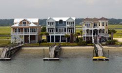 Location, location, location: A house on the beach will be much easier to rent out than one three streets over.