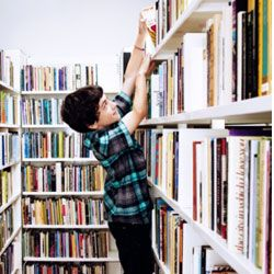 Volunteering at the library does not mean your kid has permission to climb the stacks (regardless how much he'd like to do so).