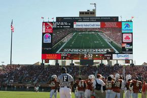 """""""Godzillatron,"""" seen here in a game between archrivals Texas and Texas A&M on Nov. 24, 2006, looms over the Longhorns football team."""
