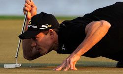 Camilo Villegas of Colombia looks over a putt on the 18th hole during the third round of the Honda Classic.