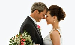A photo of the two of you sharing a tender moment is a classic for your wedding album.