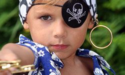As your guests arrive, they can get into pirate costume!