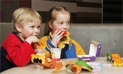 Kids eating a new Happy Meal on Aug. 29, 2006, in Australia. The new Happy Meal is a low-fat alternative to the traditional Happy Meal.