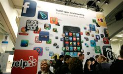 A display at the Macworld Conference and Expo in San Francisco, Calif., in January 2009, promotes the iPhone's capability to run many applications.