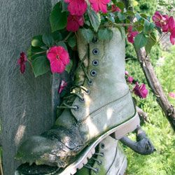 Old work boots make ideal outdoor planters.