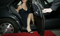 Have someone open car doors for your guests, so they can step out onto the carpet in style.