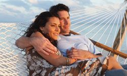 Honeymooners spend $8.3 billion a year for hammock snuggling like this. See more pictures of paradise.