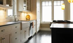 Put away the small appliances in the kitchen -- clear countertops will give the room a neater, more neutral feel.