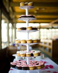 A whimsical tower of cupcakes makes a chic statement and will photograph beautifully.