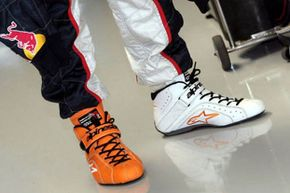 Several drivers have been known for wearing mismatched racing shoes – this pair belongs to Robert Doornbos, a Formula One test and racing driver from the Netherlands.