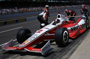 Juan Pablo Montoya comes in for a pit stop during the 98th running of the Indianapolis 500 Mile Race at Indianapolis Motor Speedway on May 25, 2014.