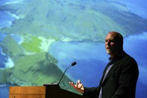 """J. Craig Venter speaks after a screening of """"Cracking the Ocean Code,"""" at the American Museum of Natural History in 2006. Venter and his team have discovered at least 5 million new genes and 7,000 new microbial species in waters all over the planet."""