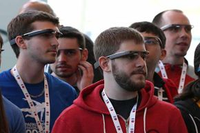 Attendees wear Google Glass while posing for a group photo during the Google I/O developer conference in San Francisco, 2013.