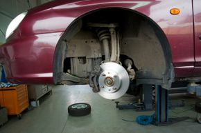 If axle grease or caliper lube gets on the friction surface of the brake pads or rotors, your car's brakes won't work.