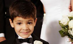 Just because he's in an itty-bitty tux doesn't mean he's not the same wild kid with torn jeans and muddy sneakers.