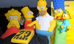 """Image Gallery: TV Shows """"The Simpsons"""" paved the way for many adult cartoons to come. Here, the characters celebrate at a 20th-anniversary party. See more pictures of TV shows."""
