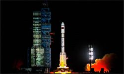 China's first space laboratory module Tiangong-1 lifts off from the Jiuquan Satellite Launch Center on Sept, 29, 2011, with a little help from a Long March rocket.