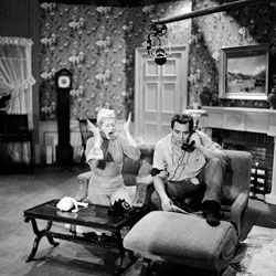 """Lucille Ball and Desi Arnaz on the set of their hit show """"I Love Lucy,"""" one of the first sitcoms to be beloved by generations of viewers."""