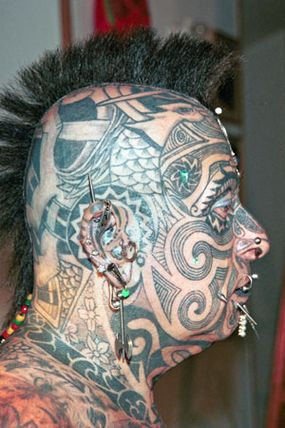 Location of the tattoo is almost as important as the tattoo itself. As a tattoo virgin, leave the face alone.