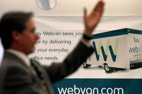 An auctioneer taking bids during the sale of Webvan's assets at its former headquarters in Foster City, Calif. on Oct. 31, 2001.