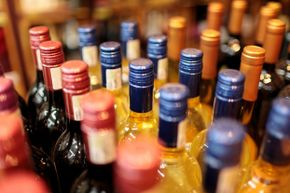 Shop the bargain stores to score wine, beer and spirits at a percentage of the regular price.