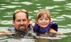 Teaching your kids to swim is a great way to bond on vacation.