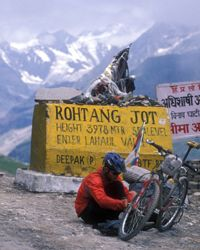 Bicycle touring at the top of the 13,000-foot (3,962-meter) high Rohtang La mountain pass in the Himalayas region of Ladakh, India.