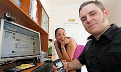 Brian McGee, right, and his wife Megan Gelabert-McGee are shown in their home in Charlotte, N.C. As Facebook and Twitter change the way we communicate, the rules of etiquette surrounding these interactions is still evolving.