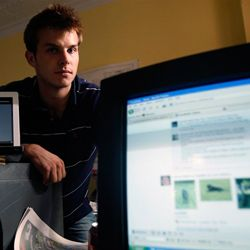 Dan Fitzsimmons poses with a computer with his Facebook page displayed in Albany, N.Y., in 2009.