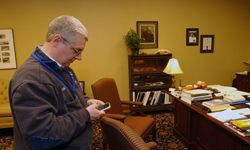Madisonville, Ky., Mayor William Cox replies to question posted on his Facebook page with his iPhone on Feb. 5, 2009.