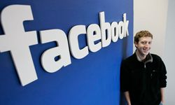 Facebook.com's mastermind, Mark Zuckerberg smiles at his office in Palo Alto, Calif., in 2007.