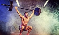 Athletic man doing weightlifiting