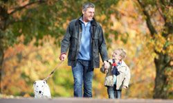 Head to the park with your son and the family dog in tow.