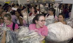 Brides swarm the racks at Filene's Basement during Running of the Brides.