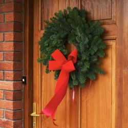 A beautiful wreath on the door welcomes guests to holiday celebrations.