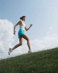 Running hills helps strengthen your lower body in preparation for a 10K.