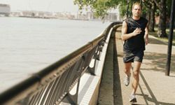 A man races from one landmark to the next along the River Thames in London.