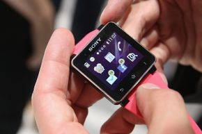 Visitors try out the SW2 smartwatch at the Sony stand at the IFA 2013 consumer electronics trade fair in Berlin, Germany.