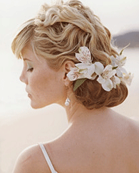 """Adding a few waves to your hair may help you beat the heat, even if you're saying """"I do"""" at the beach."""