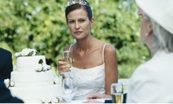 She's worried that cake will end up on her face after the champagne toast.